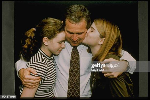 Governor of Texas George W Bush hugging his daughters Barbara and Jenna