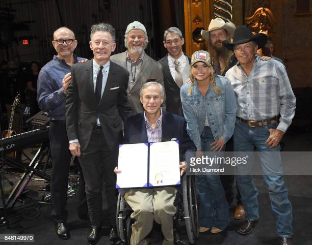 Governor of Texas Greg Abbott designates Sept 12 Hand in Hand Day presenting the proclamation to George Strait with Founder/CEO of Messina Touring...