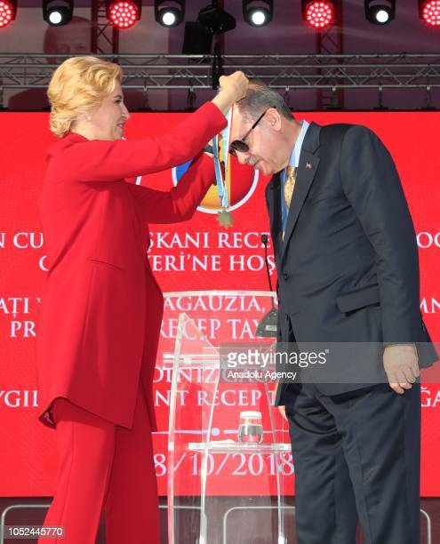 Governor of the Autonomous Territorial Unit of Gagauzia Irina Vlah presents a Medal of Gagauzia to President of Turkey Recep Tayyip Erdogan during...