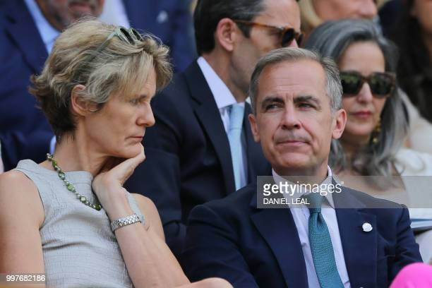 Governor of the Bank of Englan Mark Carney takes their seat in the Royal box on Centre Court to watch US player John Isner play South Africa's Kevin...