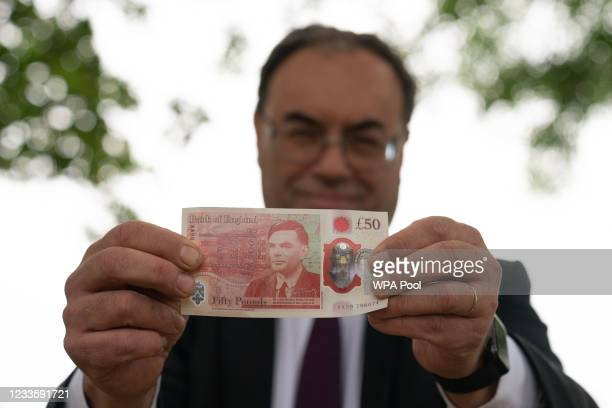 Governor of the Bank of England, Andrew Bailey with the new £50 note which features Alan Turing, at Bletchley Park on June 21, 2021 in Milton Keynes,...