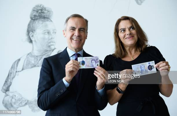 Governor of the Bank of England Mark Carney and British artist Tracey Emin pose for a photograph with the new twenty pound notefeaturing late British...