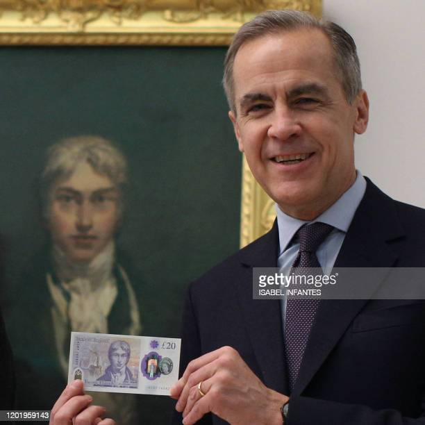 Governor of the Bank of England Mark Carney displays the new twenty pound note wich features British painter JW Turner in front of Turners...