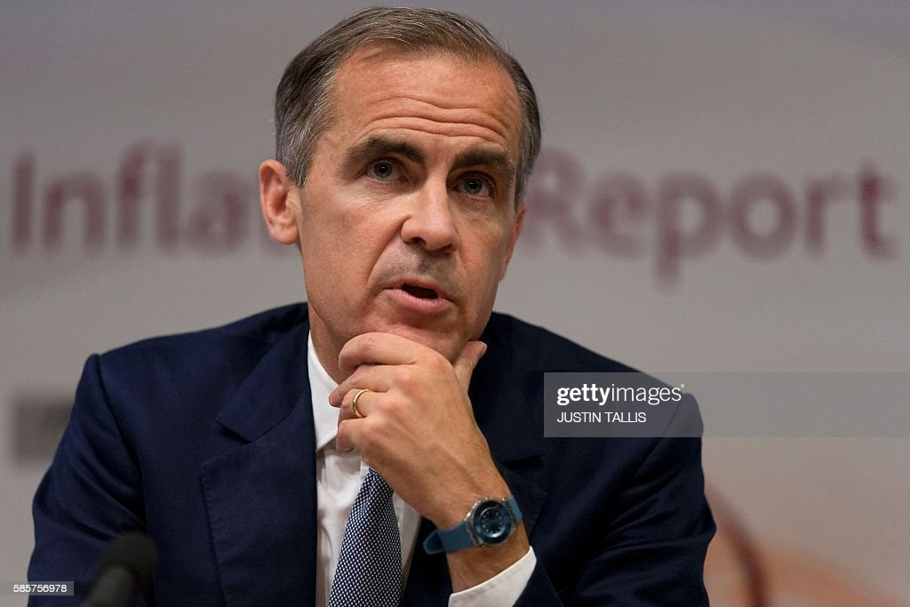 Governor of the Bank of England Mark Carney hosts a quarterly Inflation Report press conference at the Bank of England in central London, on August 4, 2016. The Bank of England on Thursday cut interest rates to a record low 0.25 percent in a vast stimulus package aimed at preventing recession after Brexit. TALLIS