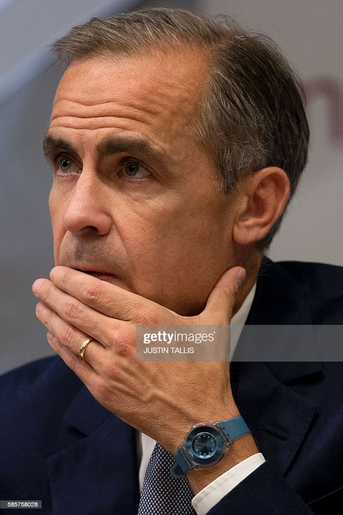 Governor of the Bank of England Mark Carney is pictured as he hosts a quarterly Inflation Report press conference at the Bank of England in central London, on August 4, 2016. The Bank of England on Thursday cut interest rates to a record low 0.25 percent in a vast stimulus package aimed at preventing recession after Brexit. TALLIS
