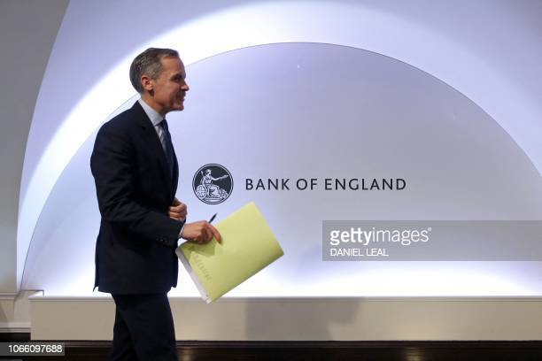 Governor of the Bank of England Mark Carney leaves after attending a Financial Stability Report press conference at the Bank of England in central...