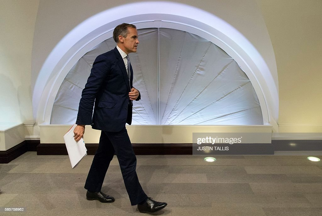 Governor of the Bank of England Mark Carney leaves after hosting his quarterly Inflation Report press conference at the Bank of England in central London, on August 4, 2016. The Bank of England on Thursday cut interest rates to a record low 0.25 percent in a vast stimulus package aimed at preventing recession after Brexit. TALLIS