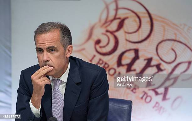Governor of the Bank of England Mark Carney looks on during the quarterly inflation report press conference at the Bank of England on August 6 2015...