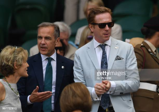 Governor of the Bank of England, Mark Carney talks with actor Damian Lewis as they take their seat in the Royal box on Centre Court to watch US...