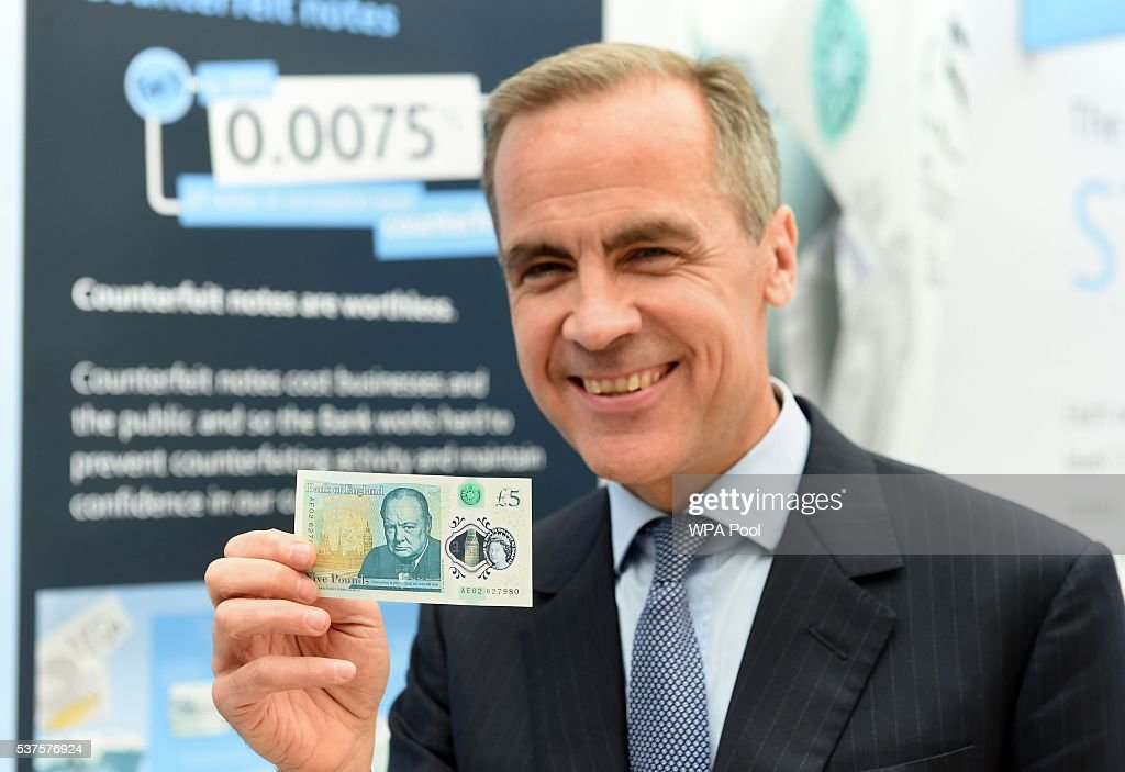 Governor of the Bank of England, Mark Carney, unveils the full design of the new polymer £5 note featuring Sir Winston Churchill at Blenheim Palace on June 2, 2016 in Woodstock, England. The new fiver will be issued in September, and in a break from the current paper notes it will be printed on polymer, a thin flexible plastic film, which is seen as more durable and more secure.