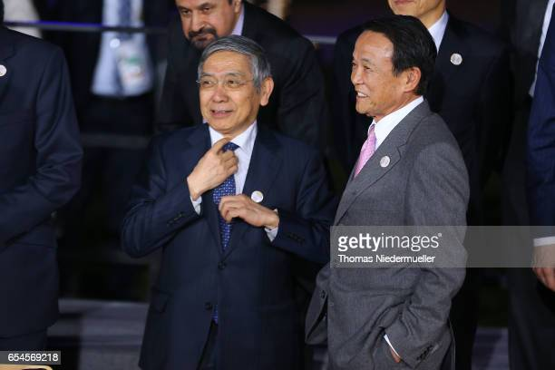 Governor of the Bank of Japan Haruhiko Kuroda and Japanese Finance Minister Taro Aso attend the family photo during the G20 finance ministers meeting...