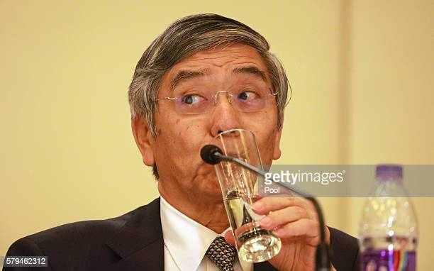 Governor of the Bank of Japan Haruhiko Kuroda sips from a glass during a press conference held at the close of the G20 Finance Ministers and Central...