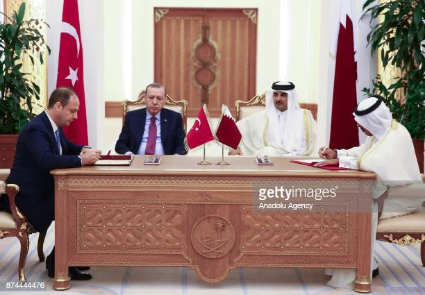 Governor of the Central Bank of Turkey Murat Cetinkaya signs an agreement on behalf of Turkey as he is flanked by President of Turkey Recep Tayyip...