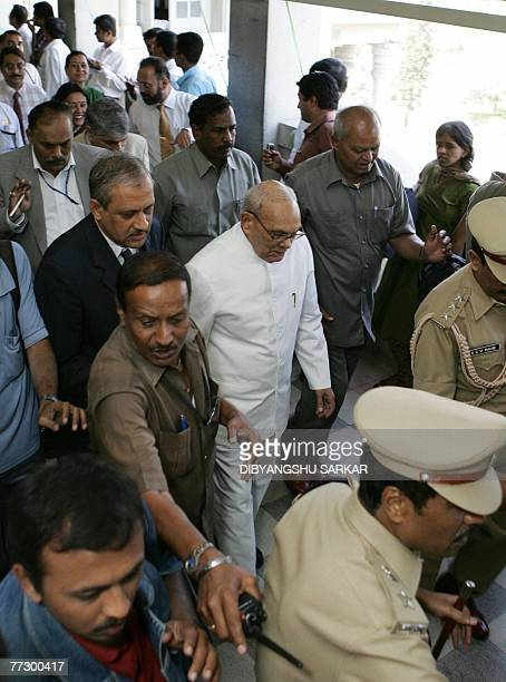Governor of the Indian state of Karnataka Rameswar Thakur walks with other goverment officials makes his way to attend a meeting at The Vidhan Soudha...