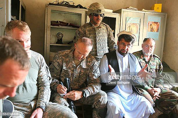 Governor of the Nuristan provinceTamim Nuristani meets with village elders police and officers of the US and Afghan military to discuss solutions to...