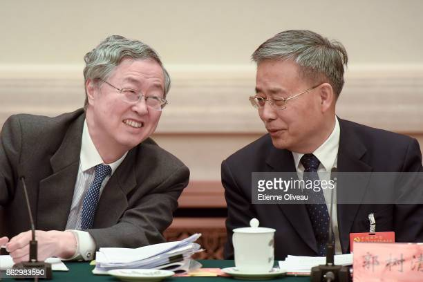 Governor of the People's Bank of China Zhou Xiaochuan and Chairman of the China Banking Regulatory Commission Guo Shuqing talk to each other during a...