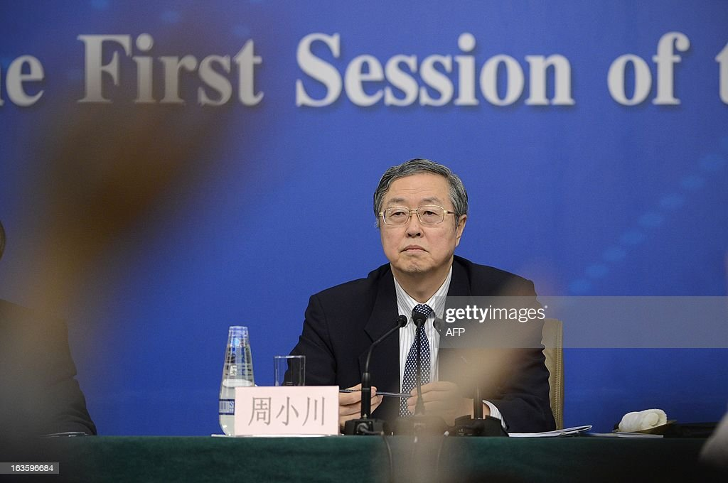 Governor of the People's Bank of China, Zhou Xiaochuan attends a press conference in the first session of the 12th National People's Congress (NPC) in Beijing on March 13, 2013. Thousands of delegates from across China meet this week to seal a power transfer to new leaders whose first months running the Communist Party have pumped up expectations with a deluge of propaganda.