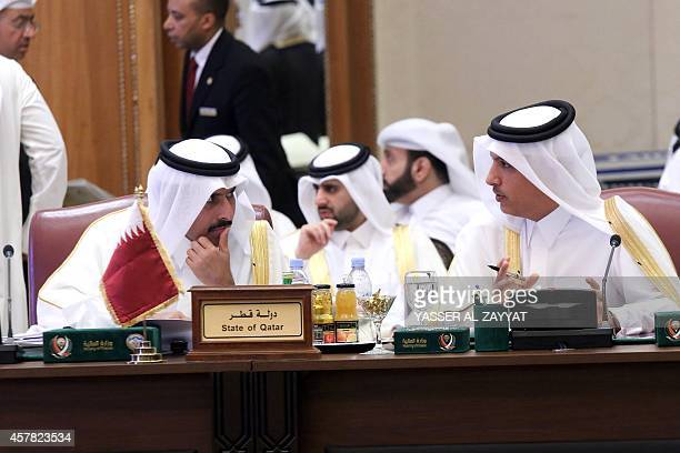 Governor of the Qatar Central Bank Sheikh Abdulla Saud alThani and Qatari Finance Minister Ali Sheriff alEmadi take part in the annual meeting of the...