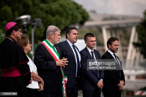 Governor of the region of Liguria Giovanni Toti and the mayor of Genoa Marco Bucci pay tribute to the victims during a minute of silence and a...