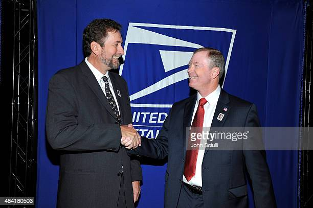 Governor of the United States Postal Service, Mickey D. Barnett and director Fraser Heston attend the postage stamp ceremony during the 2014 TCM...