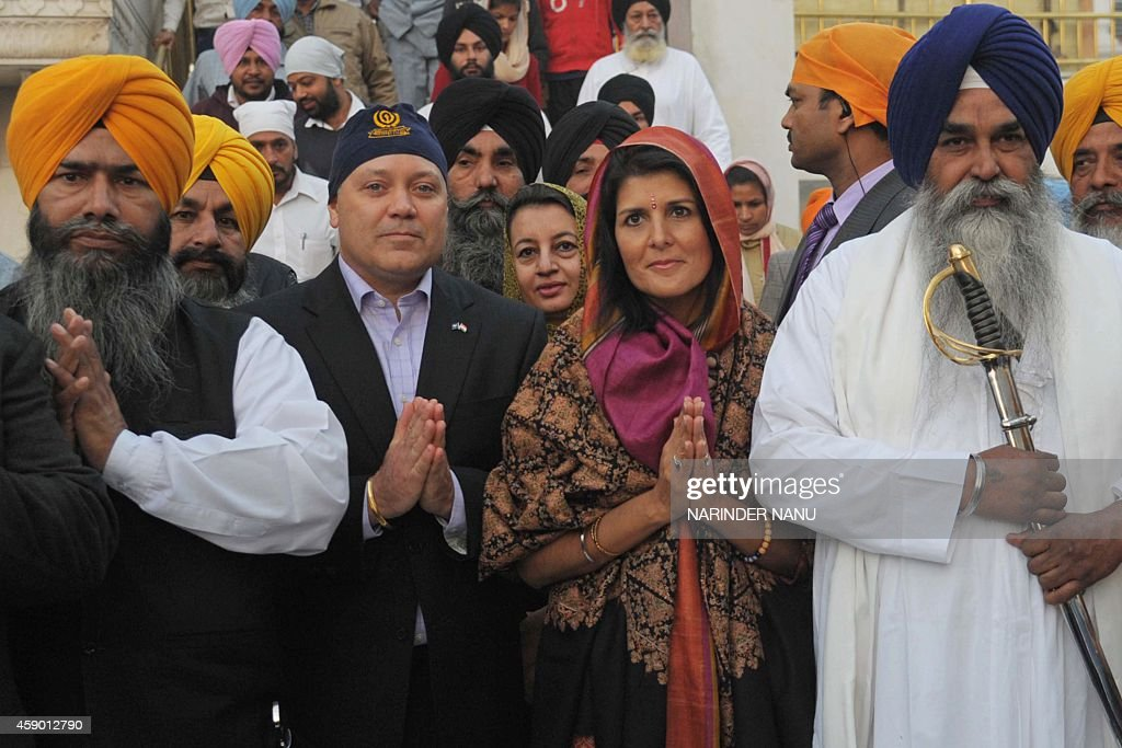 Governor of the US State of South Carolina Nikki Haley her husband Michael Haley Sikh head Priest Jaswinder Singh and officials pose at the Golden...