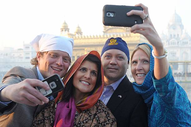 Governor of the US State of South Carolina Nikki Haley her husband Michael Haley and officials pose as they take selfies at the Golden Temple in...
