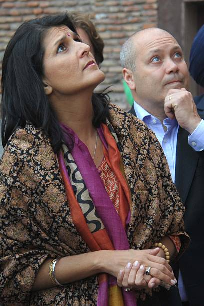 Governor of the US state of South Carolina Nikki Haley her husband Michael Haley look at bullet holes at the Jallianwala Bagh martyrs memorial in...