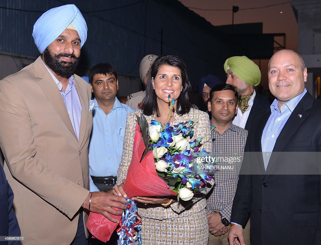 Governor of the US State of South Carolina Nikki Haley poses with Punjab Cabinet Minister Bikram Singh Majithia her husband Michael Haley and...