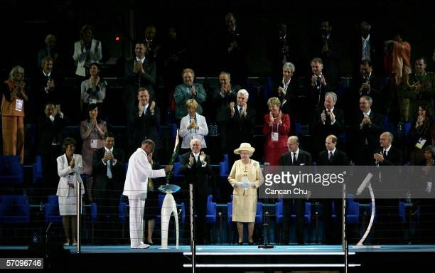 Governor of Victoria John Landy presents the Queen's Baton to Her Majesty Queen Elizabeth II during the Opening Ceremony for the Melbourne 2006...