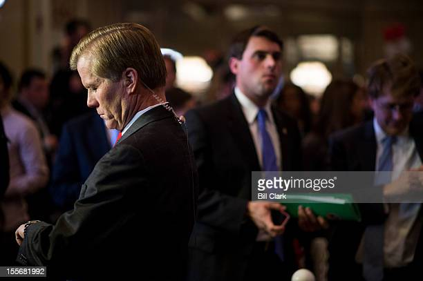 Governor of Virginia Bob McDonnell checks his watch as he prepares for a television news interview at the Virginia Republicans' election night party...
