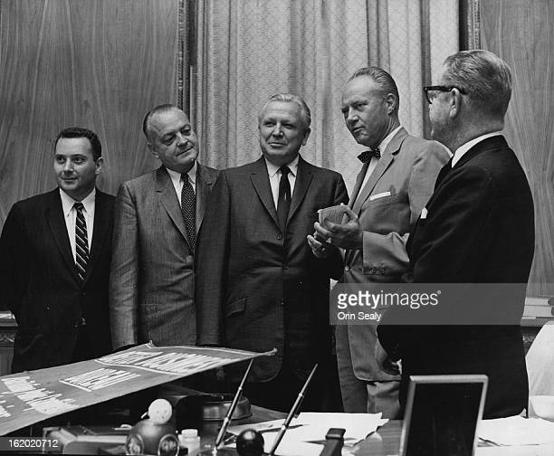 AUG 31 1962 Governor Promotes Better Business Members of the Denver Better Business Bureau present a paper to Gov Steve McNichols second from right...