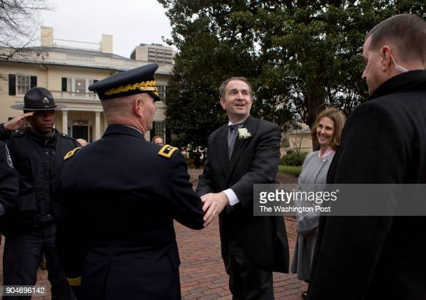 Governor Ralph Northam and his wife Pam walk into the executive mansion grounds after the Inauguration ceremony Saturday January 13 2018 in Richmond...