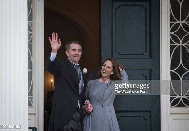 Governor Ralph Northam and his wife Pam wave as they walk into the executive mansion for the first time after his inauguration Saturday January 13...