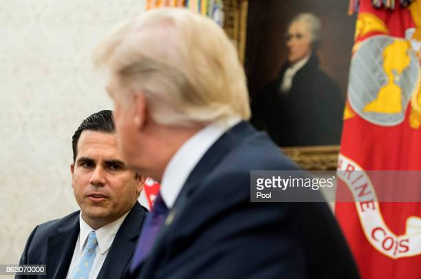 Governor Ricardo Rossello of Puerto Rico speaks with President Donald Trump during a meeting in the Oval Office at the White House on October 19 2017...