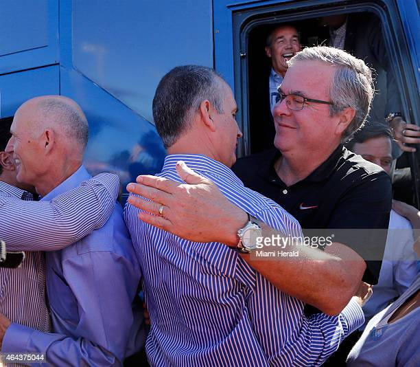 Governor Rick Scott left greets supporters as Jeb Bush right embraces Mario DiazBalart The governor race Jeb Bush campaigned alongside Gov Rick Scott...