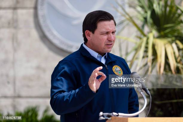 Governor Ron DeSantis gives a briefing regarding Hurricane Dorian to the media at National Hurricane Center on August 29 2019 in Miami Florida...