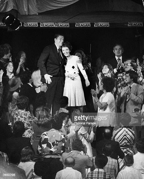 Governor Ronald Reagan and his wife Nancy Reagan stand on stage receiving applause as he prepared to address delegates at the Republican National...