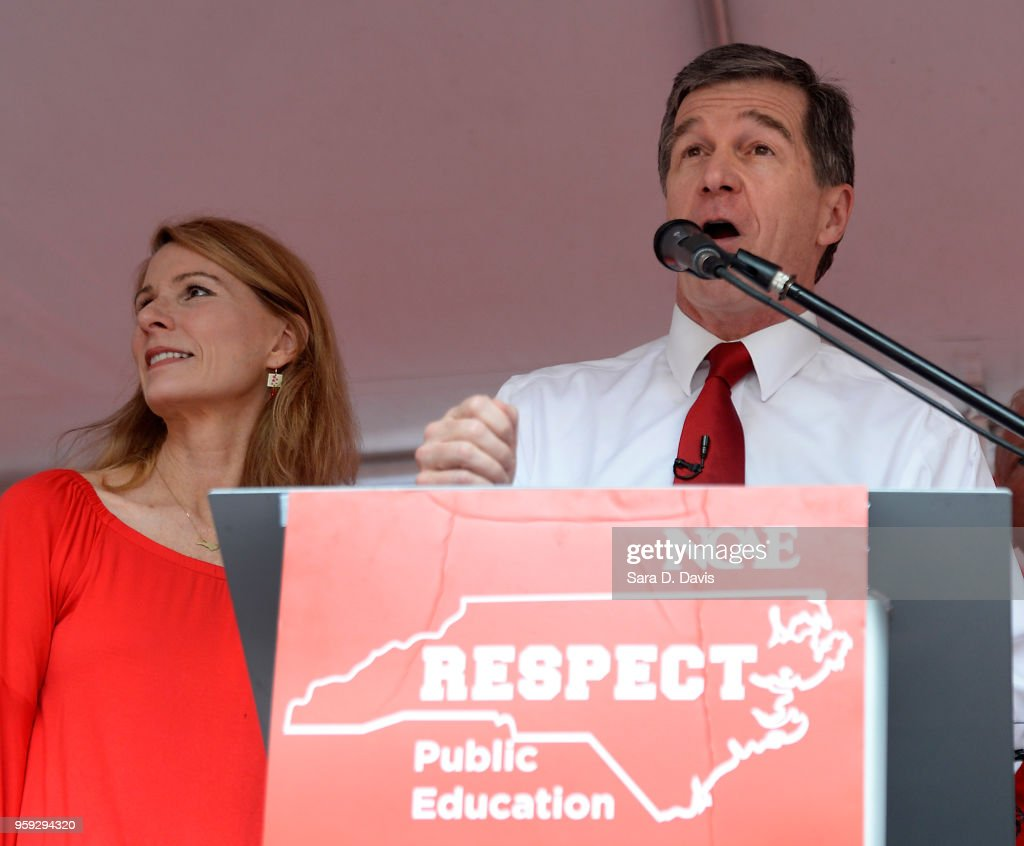 Governor Roy Cooper, D-NC address the crowd during the Rally for Respect outside the North Carolina Legislative Building on May 16, 2018 in Raleigh, North Carolina. Several North Carolina counties closed schools to allow teachers to march on the opening day of the General Assembly.