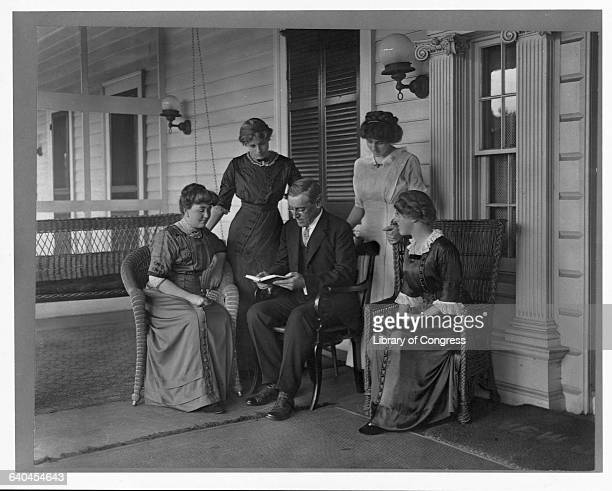 Governor Woodrow Wilson who was to become the 28th President of the United States reads to his wife and three daughters