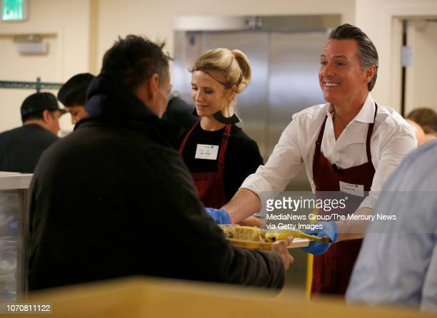 Governorelect Gavin Newsom and his wife Jennifer left hand out free meals at the St Anthony Foundation's dining room in San Francisco Calif on...