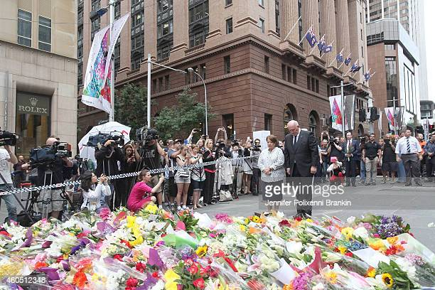 GovernorGeneral of Australia Sir Peter Cosgrove pays his respects at Martin Place on December 16 2014 in Sydney Australia Three people have been...