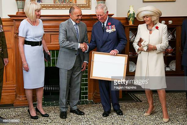 GovernorGeneral Sir Jerry Mateparae presents Prince Charles Prince of Wales with his new Military Warrants while Lady Janine Mateparae and Camilla...