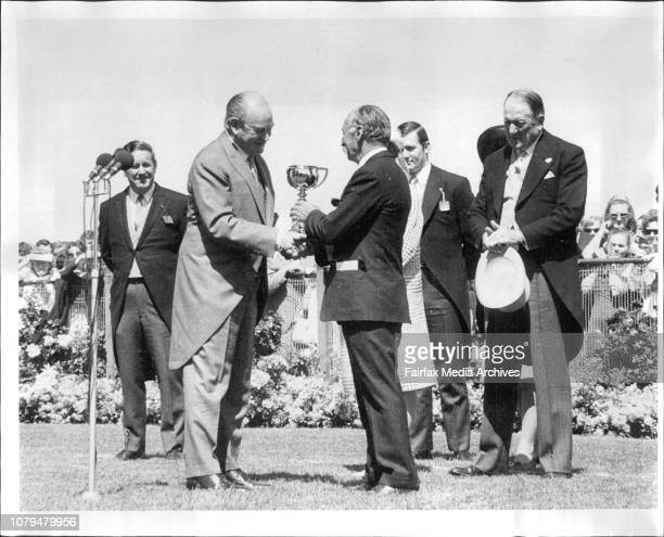 GovernorGeneral Sir Paul Hasluck presents the Melbourne Cup trophy to winning owner Mr RW Trinder November 7 1972