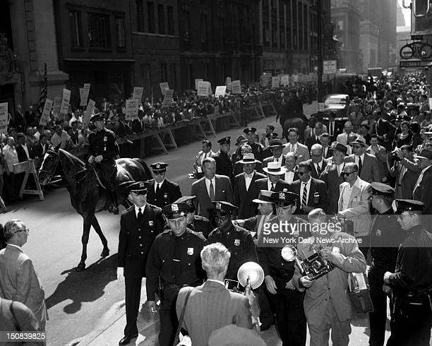 Governor's Reception Unstately Longshoremen behind police line on W 44th St voice disapproval as GovThomas Dewey arrives at Bar Association Building...