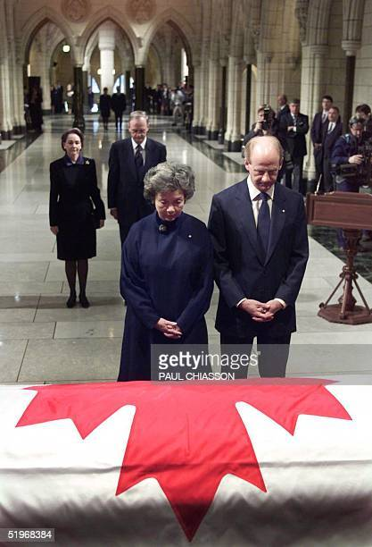 Gov.-Gen. Adrienne Clarkson and her husband John Ralston Saul stand in front of the casket bearing the remains of former prime minister Pierre...