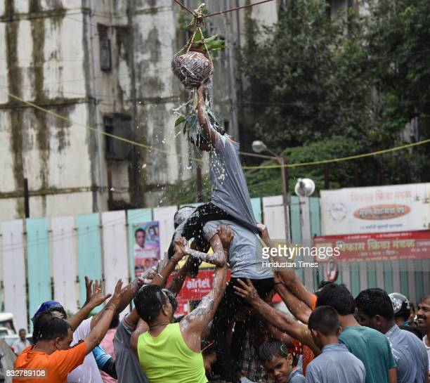 Govinda breaking Dahi Handi on the occasion of Gokulashtami at Prabhadevi on August 15 2017 in Mumbai India The childgod Krishna and his friends used...