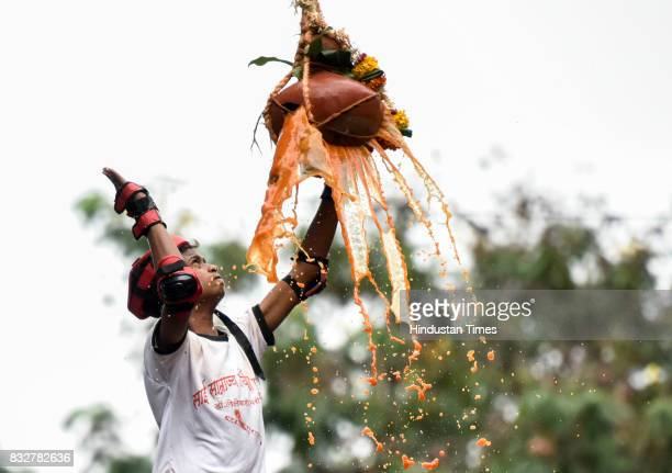 Govinda breaks the Dahi Handi an earthen pot filled with curd hanging above them as part of celebrations to mark the Janmashtami festival at Dadar on...