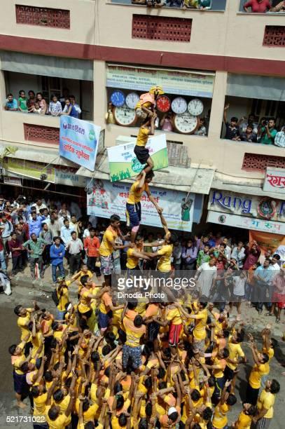 Govinda Human Pyramid Trying to Break Dahi Handi on Janmashtmi Festival in Dadar at Mumbai, India, Asia