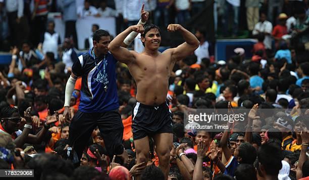 Govinda pose before they formed human pyramid to break the dahihandi curdpot during celebrations of Janmashtami which marks the birth of Hindu God...