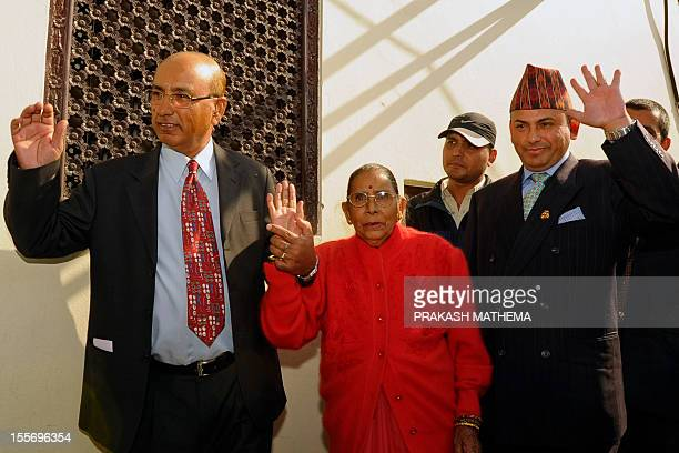 Govinda Prasad Mainali who spent 15 years in a Japanese prison gestures to journalists with his mother Chandrakala Mainali and brother Indra Prasad...